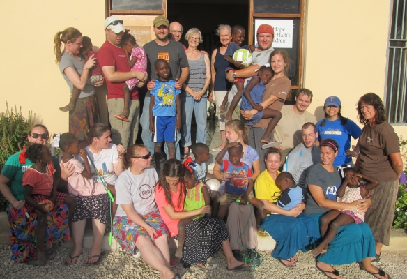 Edmond short-term missionaries pose with children in Haiti.